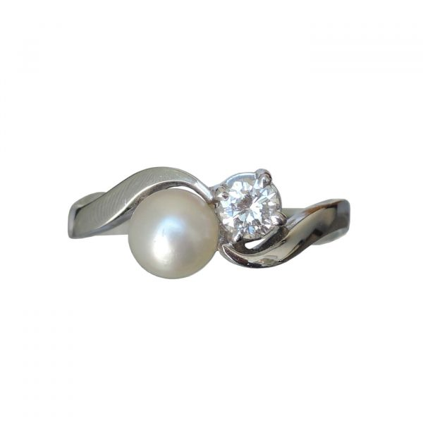 0,20 ct. diamant, parel, slag ring, wit goud